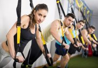 38497714 - group of people training in suspension elastic rope at gym and looking at the view